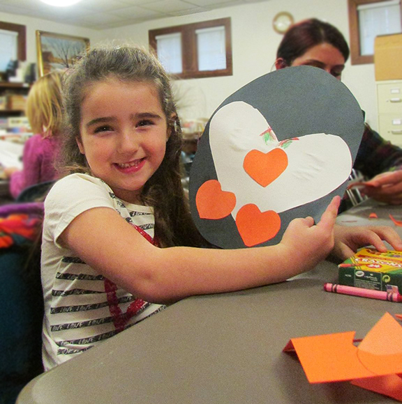 Candace Shepherd shows off the penguin she made during After School is Cool on Dec. 2. (Photo provided)