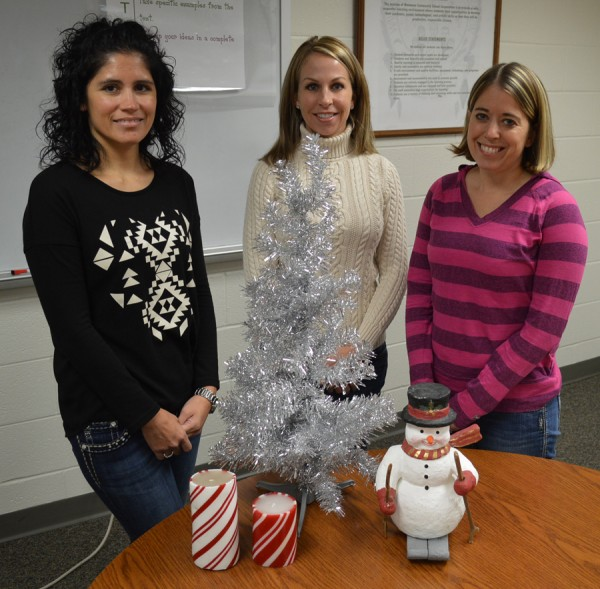 Steffanie Stookey, Shauna Young and Kristen Firestone of Wawasee Middle School PTO prepare for the annual craft bazaar Saturday. (Photo by Tim Ashley)