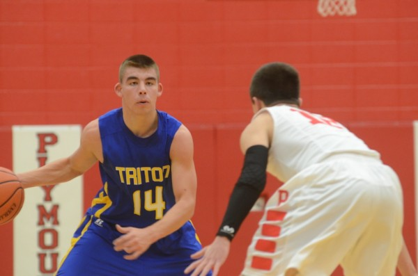 Triton's Jordan Anderson looks for room versus Plymouth Tuesday night. The host Pilgrims posted a 51-45 win.