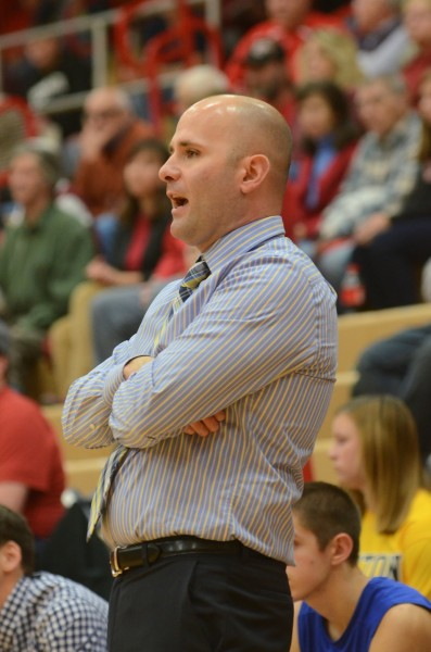 Triton coach Jason Groves gives instructions to his team at Plymouth Tuesday night.