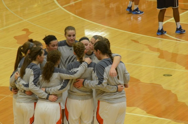 The Warsaw girls basketball team gathers together just before tip-off Saturday. The Tigers topped Michigan City 50-36 for their third straight win.
