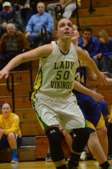 Valley's Anne Secrest gets in rebounding position. The star sophomore led the Vikings with 16 points and six rebounds.