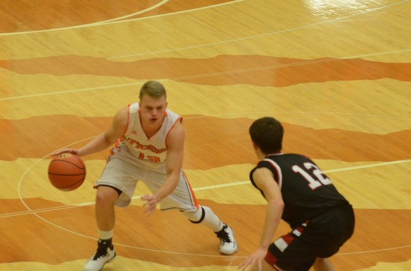 Warsaw's Peyton Long looks to go past David Mcatee of Manchester Thursday night at Warsaw (Photo by Scott Davidson)