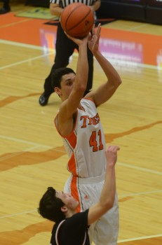Riley Rhoades goes up in the lane for the Tigers (Photo by Scott Davidson)