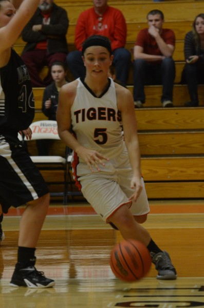 Page Desenberg drives the baseline for the Tigers.