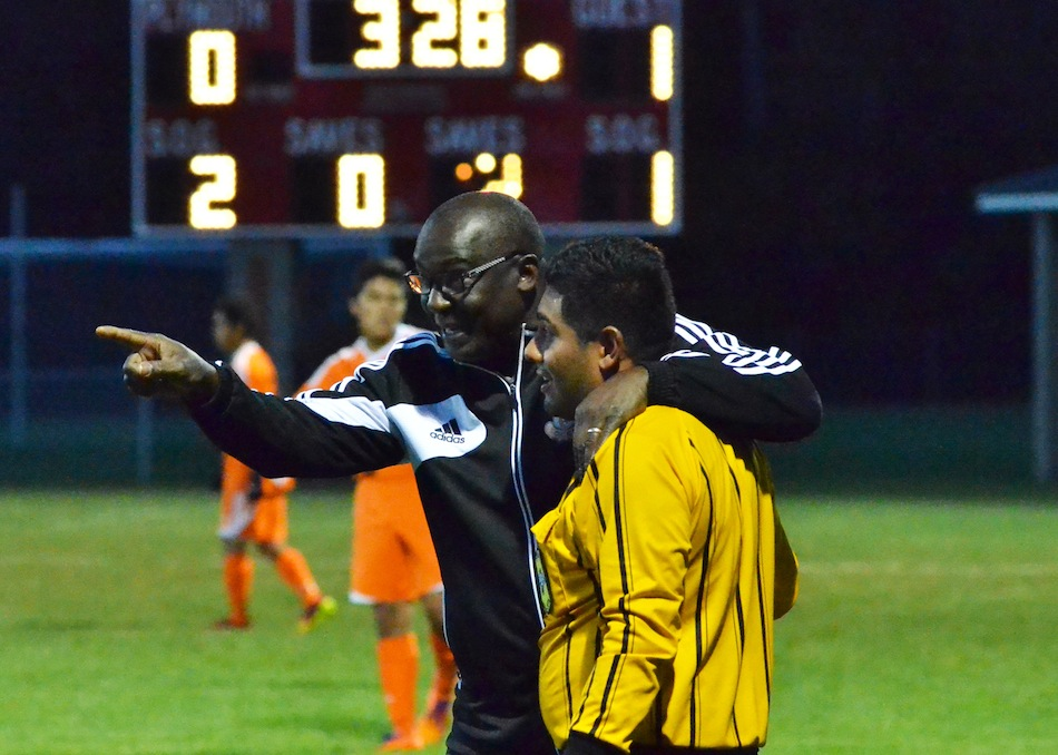 Warsaw's Frank Courtois talks with an official during the soccer sectional in October. Courtois was named tonight as the new WCHS boys soccer coach (File photo by Nick Goralczyk)