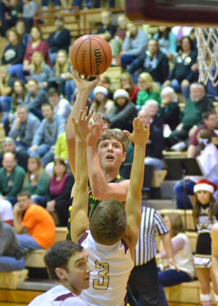 Gage Reinhard takes a contested shot Tuesday night at Columbia City. (Photos by Nick Goralczyk)