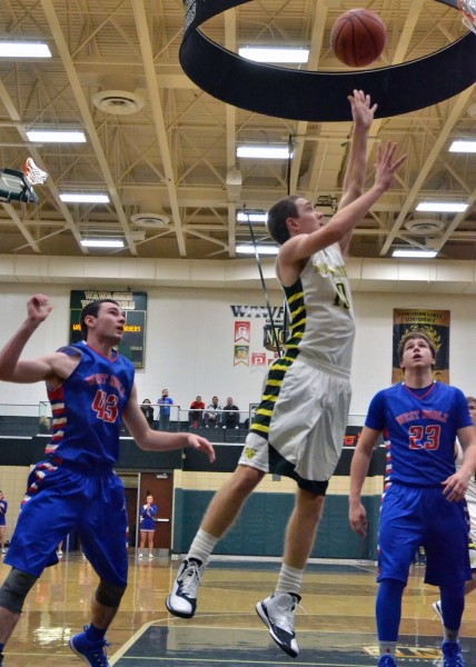 Aaron Voirol gets his first basket of the night for Wawasee.