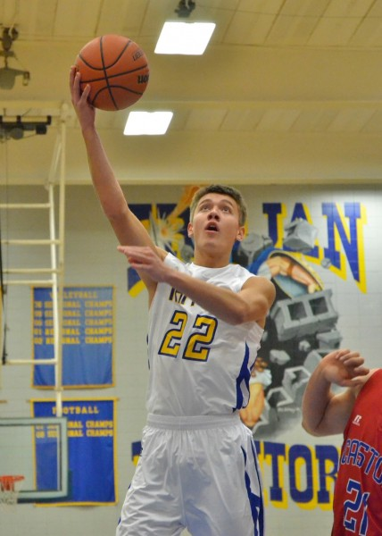 Austin Sellers lays in the first basket of the game for Triton. (Photos by Nick Goralczyk)