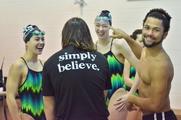 Members of the Wawasee boys and girls swim teams goof around during a break.