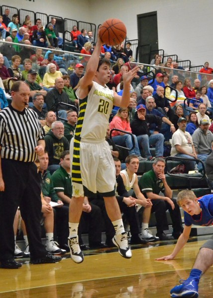 Jake Hutchinson passes the ball for Wawasee in Saturday's 69-48 win over West Noble. Hutchinson had 10 points. (Photos by Nick Goralczyk)