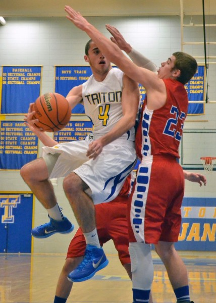 Joey Corder makes an athletic pass for the Trojans.