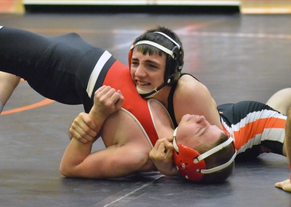 Warsaw's Kyle Hatch, shown earlier this season, will take an undefeated record into the power-packed Mishawaka Invitational (File photos by Nick Goralczyk)