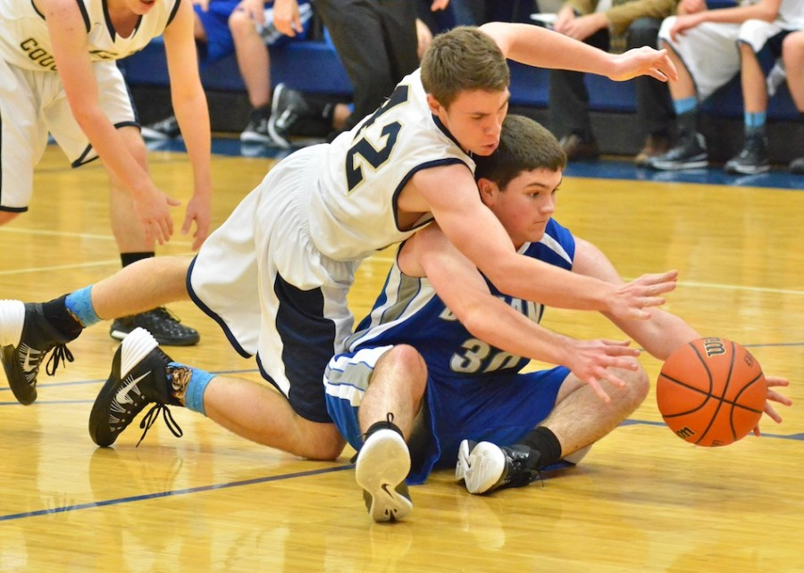 Kyle Shuler (42) dives for a loose ball over Bethany's Joel Miller.