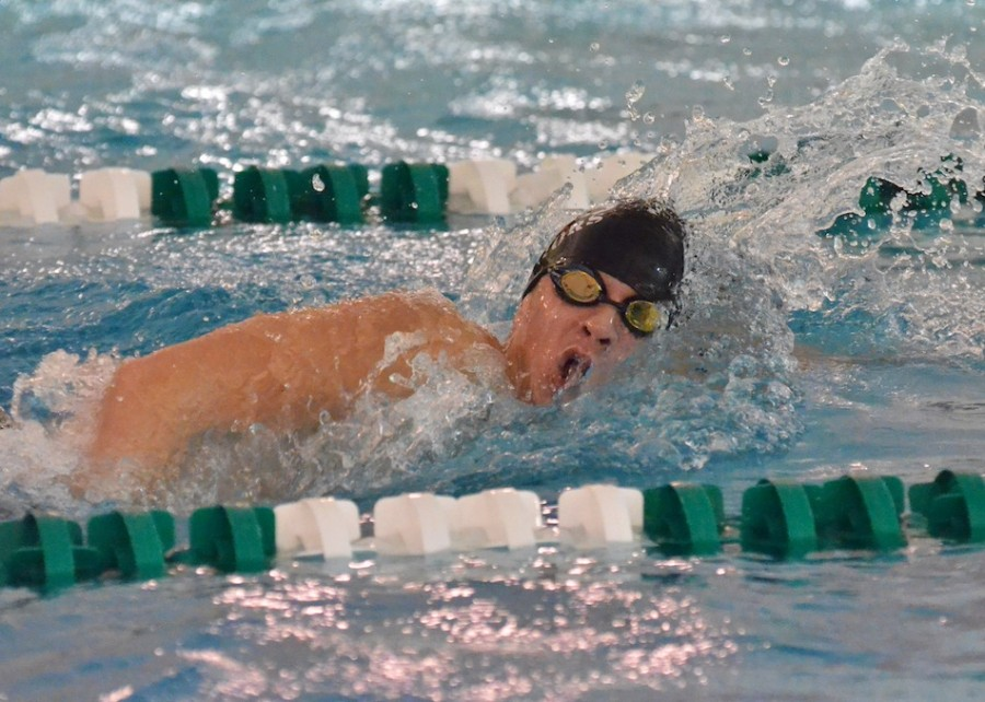 Logan Brugh was the lone Warrior to win a race Saturday as he took first in the 500 free. (Photos by Nick Goralczyk)
