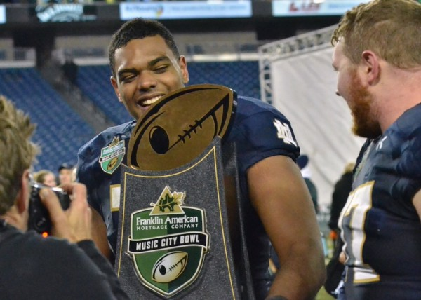Ronnie Stanley is all smiles as he carries the Music City Bowl trophy off the field for Notre Dame. (Photos by Nick Goralczyk)