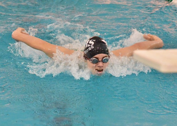 Warrior freshman Spencer Naugler comes in strong during the 100 fly.