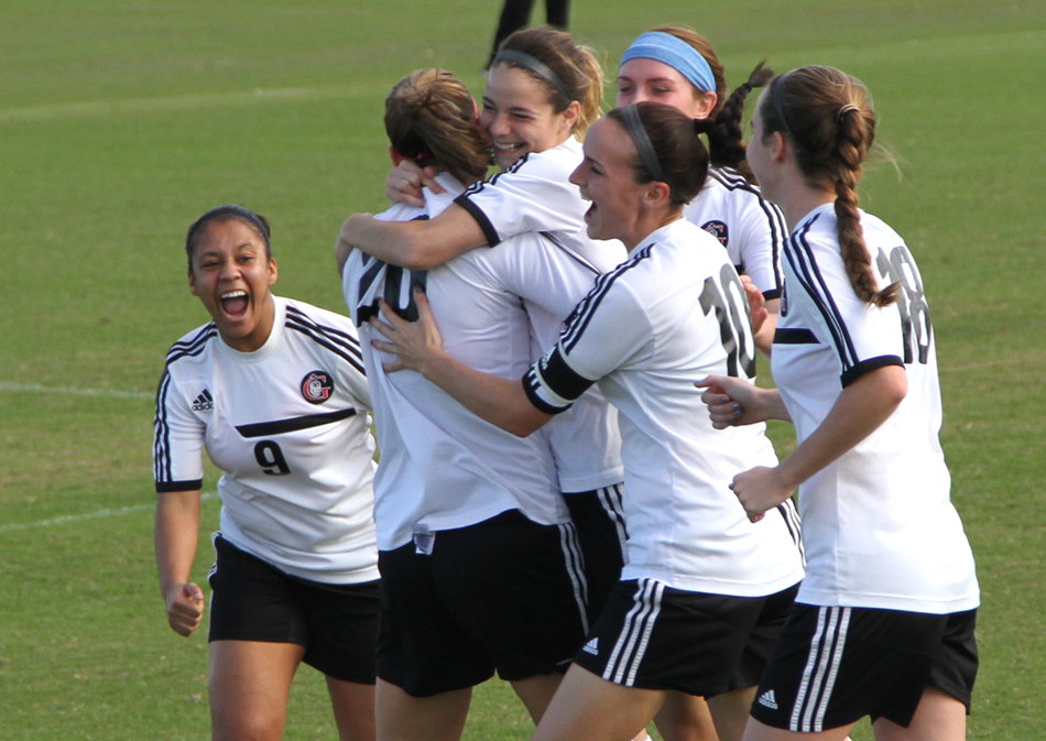 Mallory Rondeau, center, is surrounded by her Grace College women's soccer teammates celebrating a goal. Rondeau was named the NCCAA Player of the Year Wednesday. (Photo provided by the Grace College Sports Information Department)