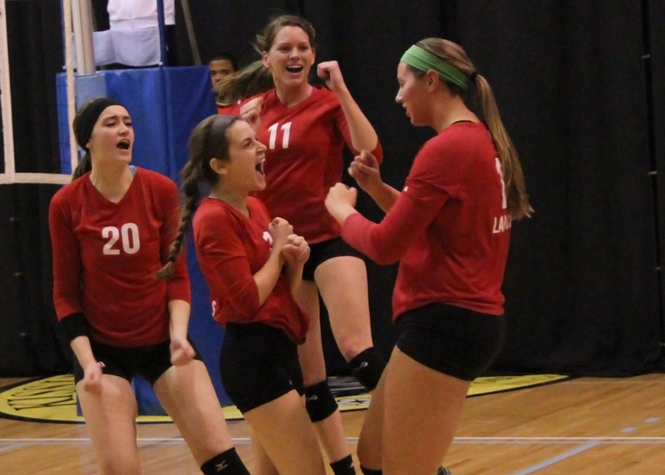 Grace College showed well at the NCCAAs, winning two games. Pictured are (left) Grace Woolsey, Jessica Scherb, Ellie Harp and Tori Bontrager celebrating a point against Oakland City Thursday. (Photo provided by the Grace College Sports Information Department)