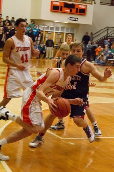 Sophomore Kyle Mangas drives for the Tigers. Mangas had 12 points Thursday night (Photo by Ansel Hygema)