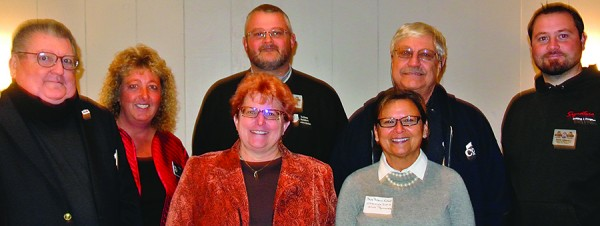 Back, L to R: IBA State President Tom Mullen, Indiana District 22 State Representative  Rebecca Kubacki, BAKFC Board President Brett Harter, Larry Coplen and David Johnson. Front, L to R: Executive Officer Joni Truex and IBA Chief Operating Officer Cindy Bussel.