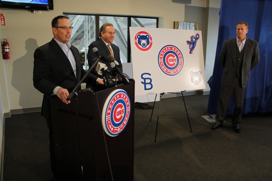 Team officials stand with the new logos at Thursday's unveiling. (Images provided by the South Bend Cubs)