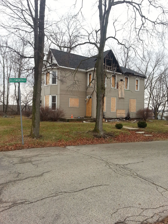 The charred remnants of Lynn Butts' apartment stands across the street from the Salvation Army, the place where hope began again for Butts. (Photo by Alyssa Richardson)