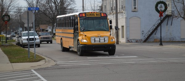 A Wawasee school bus coming from Milford School in the afternoon is stopped at the four-way stop at Main and Emeline streets in downtown Milford. New transportation software is being implemented in the Wawasee district and it is hoped it will increase efficiency, improve service and reduce costs.