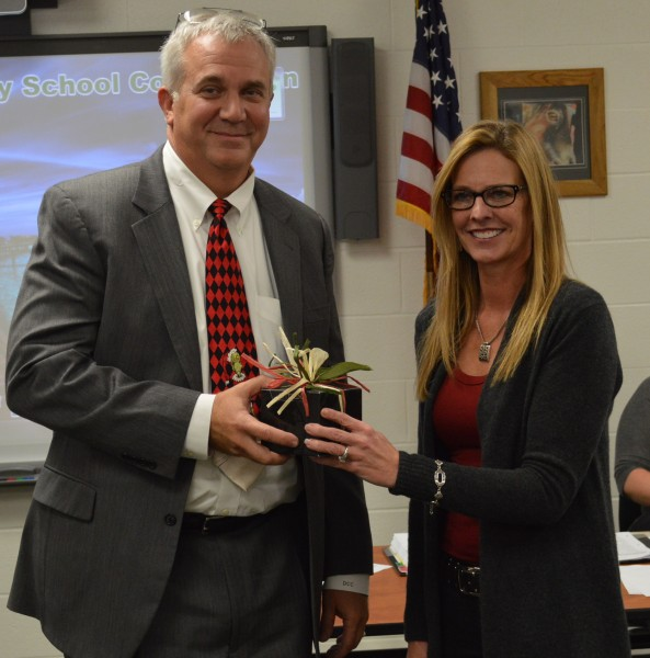David Cates, left, attorney for the Wawasee Community School Corp., was presented a watch in appreciation for his 24 years of service. Tuesday was the last school board meeting for Cates, who will become a county judge in January. Also show is Rebecca Linnemeier, school board president.