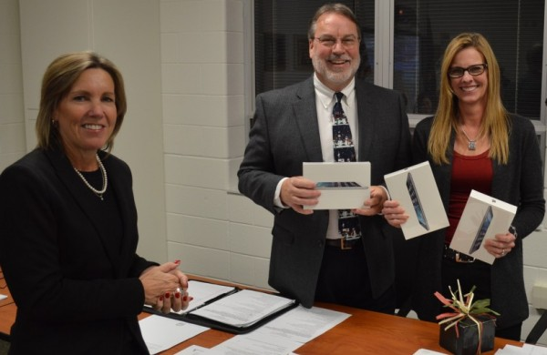 Holly Tuttle, left, of Women Today, donated three mini iPads to the Wawasee Community School Corp. to be used in each of the elementary schools. Shown accepting the iPads are Dr. Tom Edington, superintendent, and Rebecca Linnemeier, school board president.