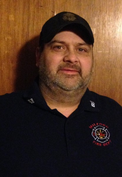 Lee Price recently retired after 27 years as a volunteer firefighter with the Milford Fire Department.