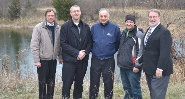 From left at the property are Bob Smith, Syracuse-Wawasee Rotary Charitable Foundation Inc. president; Erick Leffler, Syracuse-Wawasee Rotary Club president; Henry DeJulia, town manager; Jonsson; and Dr. Tom Edington, Syracuse-Wawasee Park Foundation president.