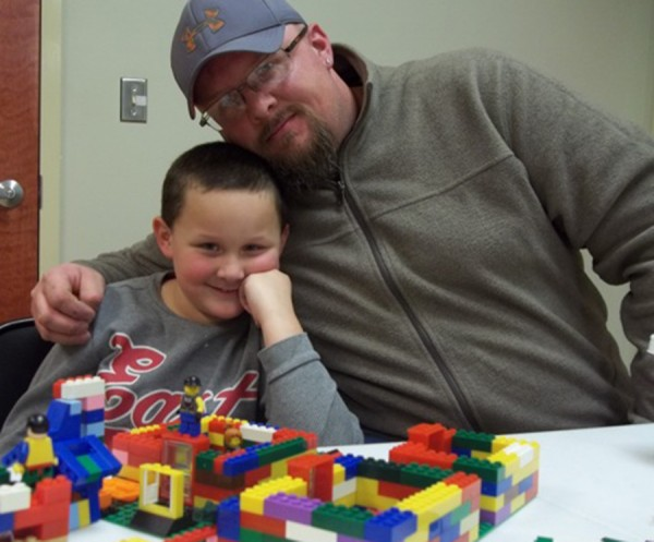 : Mason and Nick Beckman enjoy some father and son time at the library's LEGO Club.