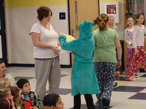 Students and teachers collect donations to help local teacher.