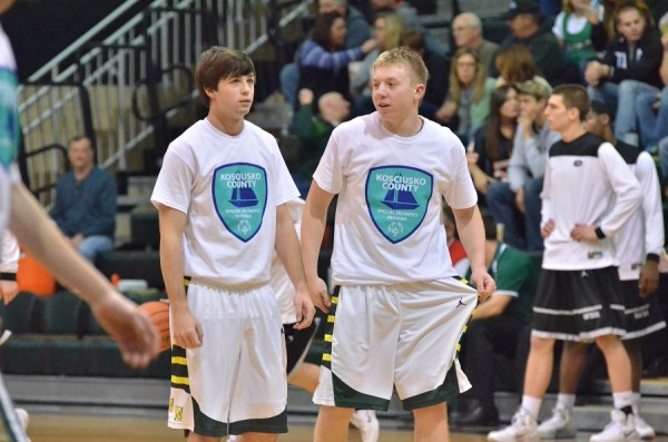 Wawasee's Jake Hutchinson and Jeffrey Moore sport Special Olympics shirts during last year's game. (Archived photo by Nick Goralczyk)