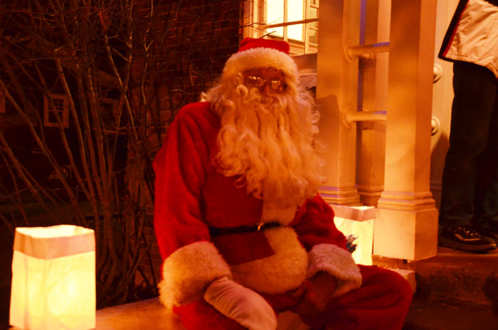Santa sits outside of the Leesburg Town Hall, awaiting the Christmas wishes of boys and girls.  (Photo by Alyssa Richardson)