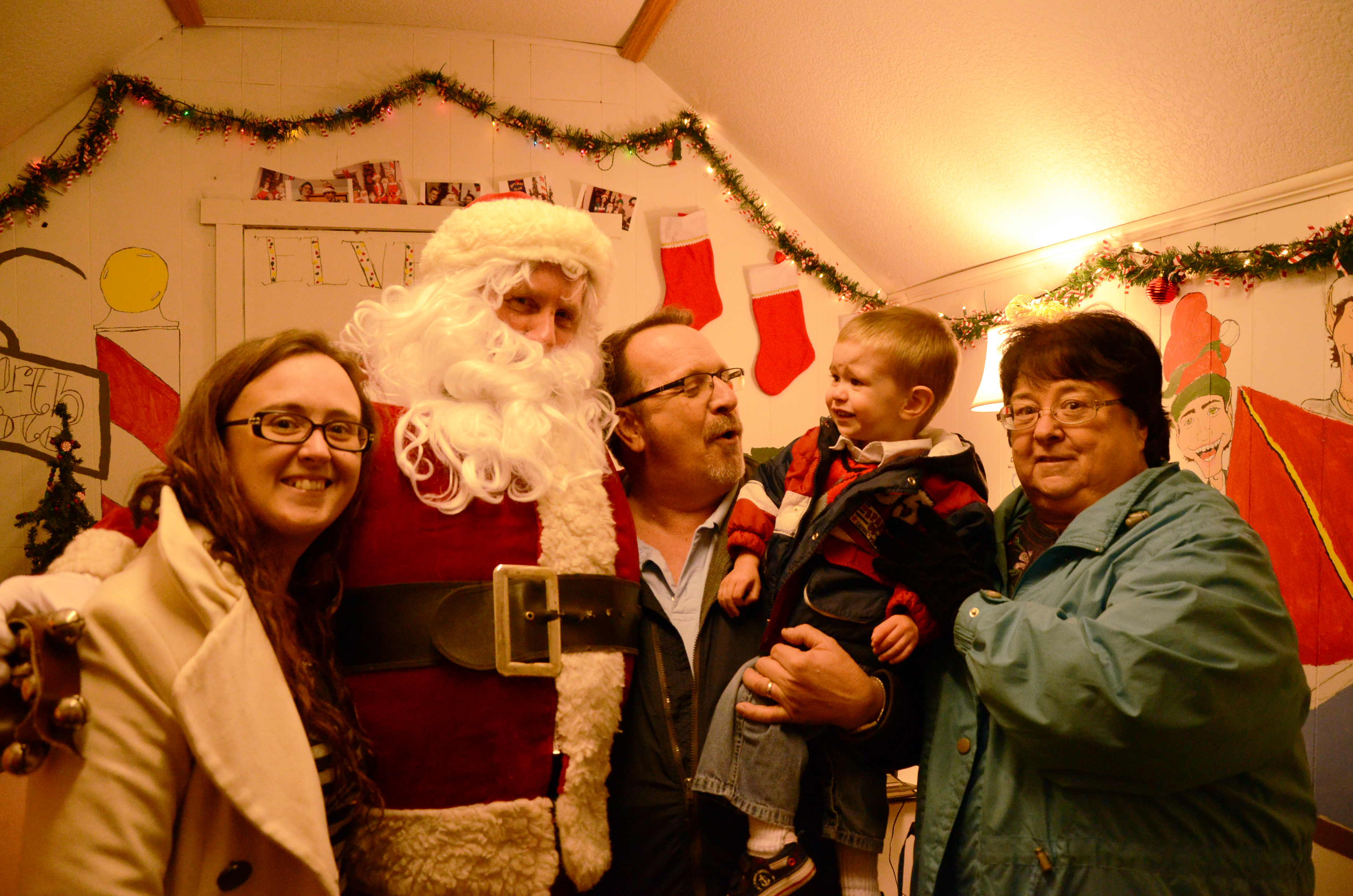 (From left) Marci Jacobs, Santa, Bob Stevens, Cooper Jacobs and Judy Jacobs celebrate First Friday.  (Photo by Alyssa Richardson)