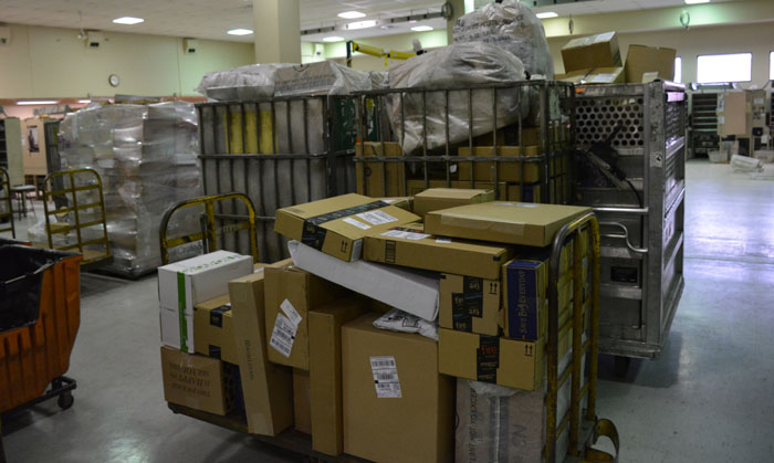 The amount of packages that come through the Warsaw post office greatly increases in December. (Photos by Jarrett Van Meter)