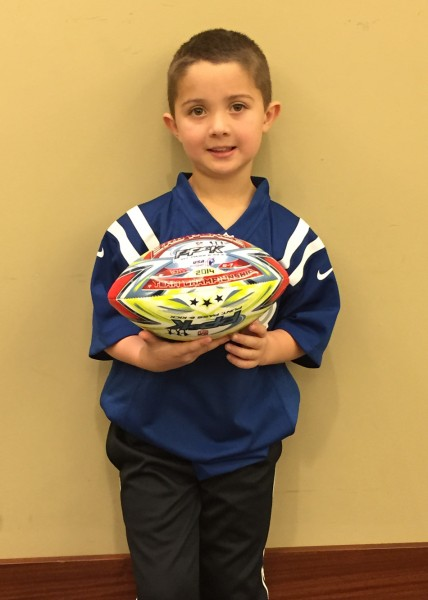 Addison Coy of Leesburg poses with the NFL Punt, Pass & Kick ball during the state competition last Sunday at Lucas Oil Stadium in Indianapolis. Coy was one of four competitors in his age group, to which he finished third overall. (Photos provided by Derek Coy)