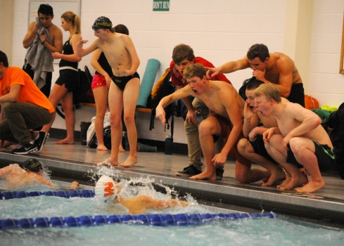 Several members of the Warsaw boys swim team cheer on Matt Wildman during the breaststroke against Northridge Thursday night. (Photos by Mike Deak)