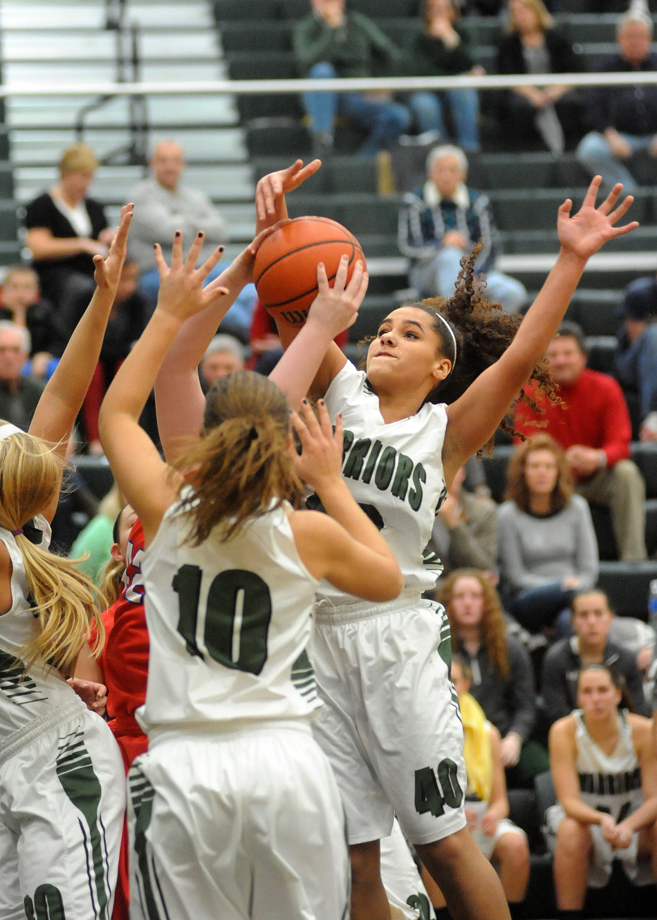 Wawasee's Seaquinn Bright, far right, swats away a West Noble shot attempt.