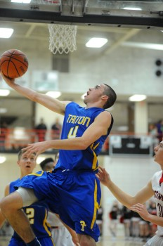 Triton's Joey Corder flies for a layup against NorthWood.