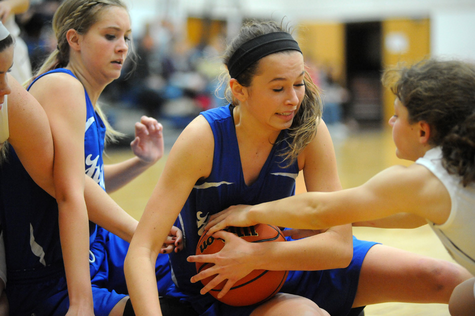 Hamilton's Emma Lucas pulls in a loose ball as Lakeland Christian Academy's Melissa Goss closes in Saturday night during Hamilton's 39-18 victory. (Photos by Mike Deak)