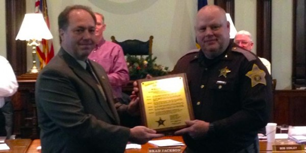 Incoming Kosciusko County Sheriff Aaron Rovenstine, left, presenting current Sheriff Rocky Goshert an Indiana Sheriff Association award.