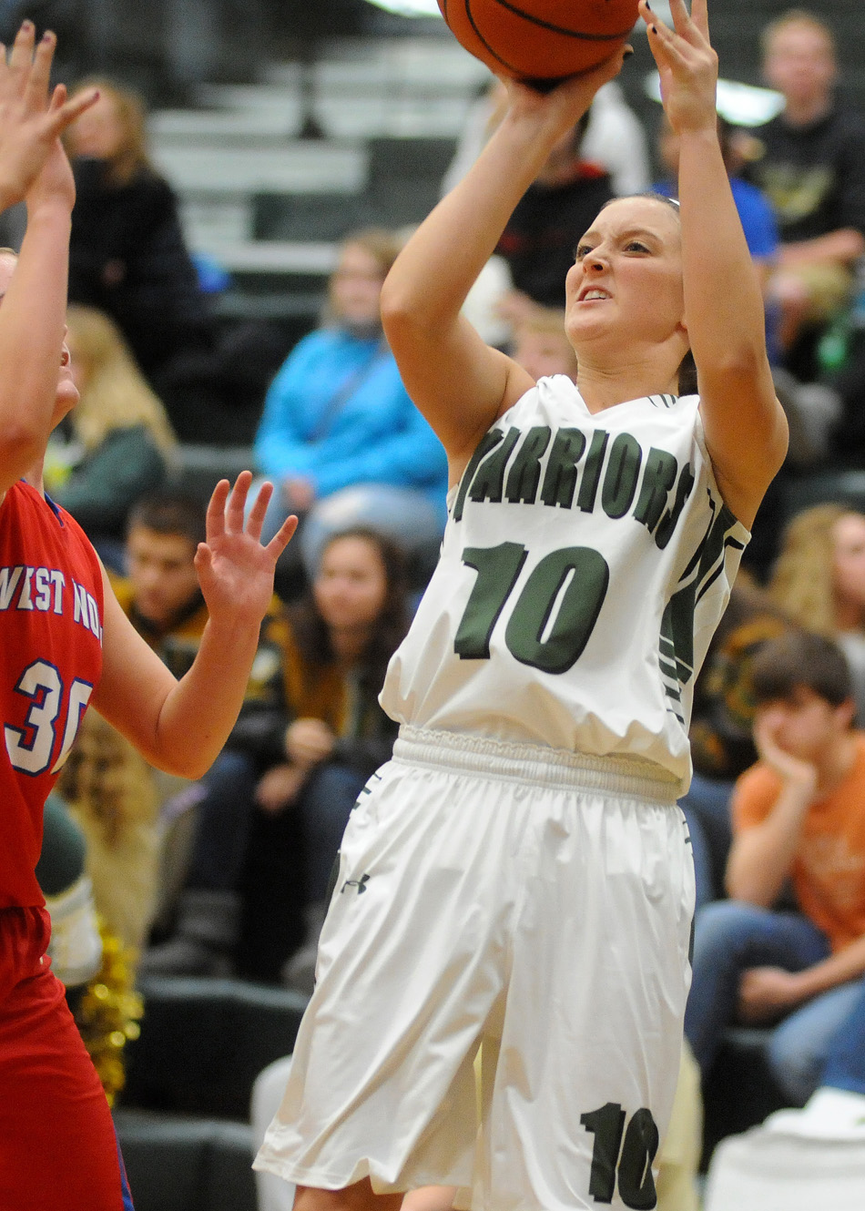 Wawasee's Elizabeth Jackson takes a shot over the defense of West Noble's Becca Schermerhorn.