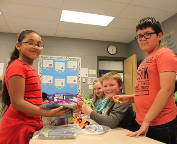 Leesburg Elementary students Gisel, Jackson, Herberto and McKenzy have fun engineering roller coasters for STEM.