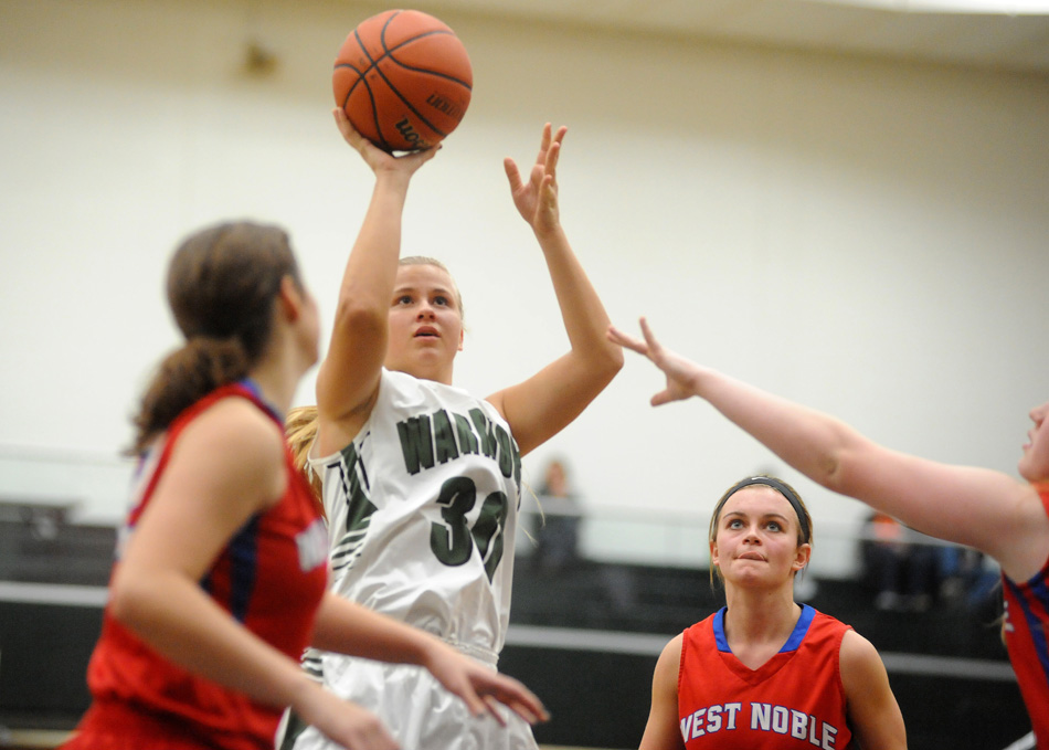 Wawasee's Kylee Rostochak puts up a shot against three West Noble defenders Tuesday night. (Photos by Mike Deak)