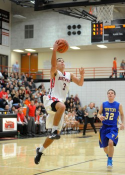 NorthWood's Braxton Linville flies in for a layup against Triton Friday night. Linville finished with 22 points in the 54-50 win over the Trojans. (Photos by Mike Deak)