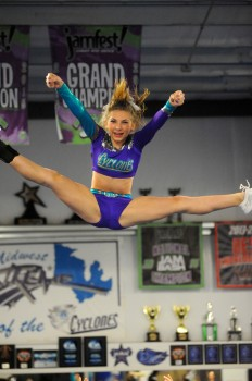 Midwest Xtreme's Madison Smith flies through the air during the C4 cheer routine. (Photos by Mike Deak)