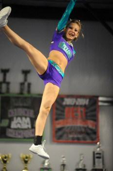 Madyson Clousing of Midwest Xtreme twists during the cheer demo.